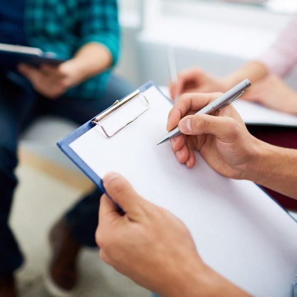 Psychologist making notes on paper sheet